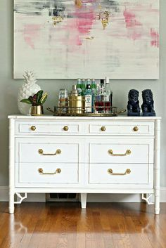 white dresser as bar with painting above