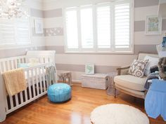 Xavier Dean's striped and serene nursery -- Moroccan pouffe from Ada and Darcy, replica Marcel Wanders stool from Sokol, Boori Country Sleigh Cot from Baby Shop Direct, Mini Louis Ghost Chair from Click on Furniture