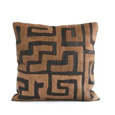 This large appliquéd geometric Kuba-cloth pillow is backed in a coordinating black linen with french seam. Small needle holes are sometimes visible from an original hand-sewn seam. Close inspection often reveals hand-sewn seams and other subtle marks from its past life. #pillow #kuba #global #textile #home