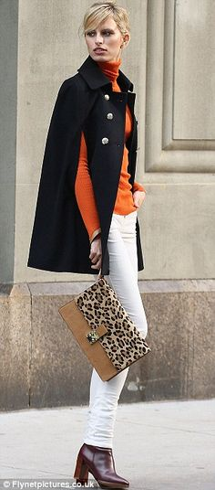 Tangerine dream: Kurkova wears white trousers with an orange turtle neck and dark cape coat New York Fashion, Runway Fashion, High Fashion, Winter Fashion, Womens Fashion, Fashion Trends, White Trousers, White Jeans, Moderne Outfits