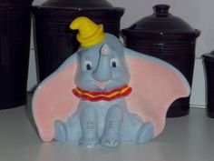 Family friend hand painted this piece of pottery. It is a Dumbo piggy bank. It is beautiful. We added it to the nursery decor.