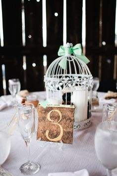 gold table numbers and bird cage centerpieces