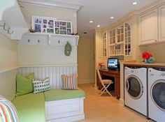 Classy laundry room that also houses a daft work station to kill time productively!