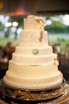 layered wedding cake with lots of texture and details