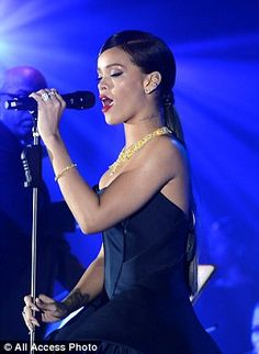 Rihanna wows in black gown as she performs at inaugural Diamond Ball Rihanna 2014, Shes Amazing, Affair, Evening Dresses, How To Memorize Things, Gowns, Concert, Celebrities, Black