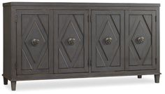 The Melange Raellen Console has a muted gray finish with storage behind the doors and can also be used as an entertainment console.