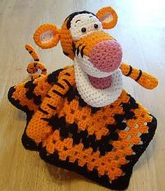 Tigger Lovey Blankie by Knotty Hooker Designs - This pattern is available for $4.00 USD. It measures appx. 15 inches square. This was a special request and I hope I have exceeded your expectations. It was definitely a challenge…..LOL Perfect for the diaper bag, car ride, crib or whatever tickles your fancy. It's smaller size makes it the perfect carry along companion for your little one. They work up quickly and easily!