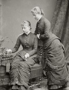 Princess Augusta Victoria , future Kaiserin of Prussia (standing) with sister, Princess Carolina Mathilde of Schleswig-Holstein. Late 1870s