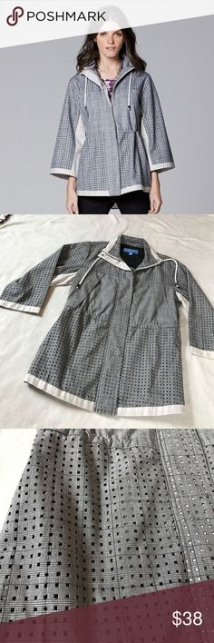 """Vera Wang Perforated Anorak Jacket Medium gray color. Has perforated detailing throughout. Zips up front. 3/4 Sleeve. Drawstring pull at collar. Oversized fit. Adjustable drawstring on side to snitch waist. 30"""" length. 18.5"""" armpit to armpit 19"""" Sleeve. Excellent condition. Bundle 2 or more items for a discount Simply Vera Vera Wang Jackets & Coats"""