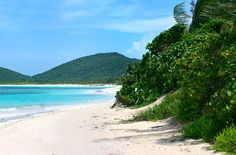 Culebra's Playa Flamenco, Puerto Rico; You want off-the-beaten path? Head to the tiny 11-square-mile island of Culebra, east of Puerto Rico proper, for Playa Flamenco—a brilliant white-sand crescent hailed by many as the world's most beautiful beach. Just a 20-minute walk from Playa Flamenco is Carlos Rosario Beach, another hidden gem with a shallow reef that makes for easy snorkeling.