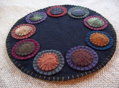 Hey, I found this really awesome Etsy listing at https://www.etsy.com/listing/189797661/penny-rug-candle-mat