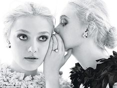 Secret siblings: Elle Fanning whispers into her big sister Dakota' ear during a photoshoot for the upcoming issue of W Magazine