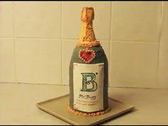 Champagne Bottle Cake - MsBurpy YouTube Featurette - YouTube Chocolate Gold, Best Chocolate, Wine Bottle Cake, Gold Dessert, 21st Cake, 3d Cakes, Cake Decorating Techniques, Distillery, Party Cakes