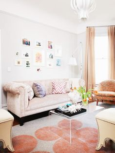 Whether you fill it with family photos or original artwork, large-scale prints or small pieces, bold hues or black and white, a salon-style gallery wall is always a good design decision. Mix frame styles and colors to create an eclectic look like Coddington Design did here, or go traditional with matching frames.