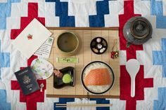 travel editorial Japanese food salmon bamboo mat teapot sarubobo tea letters stationary passport fan chopsticks top down photography