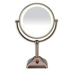 This double-sided freestanding Variable Lighted 1X/10X Mirror from Conair features evening, home, office and day settings, plus fog free viewing. Mirror conveniently rotates 360 degrees.