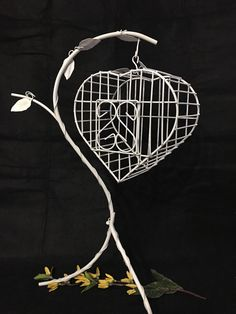 Hey, I found this really awesome Etsy listing at https://www.etsy.com/il-en/listing/289227877/wire-heart-shaped-bird-cage-and-table
