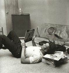 Clint Eastwood at home listening to music, 1959