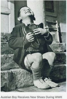 Austrian boy receives new shoes during WWI