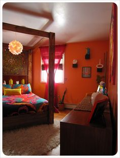 Future guest bedroom <3 Love the bed and lantern. Orange is my favorite color...duh this screams ME!