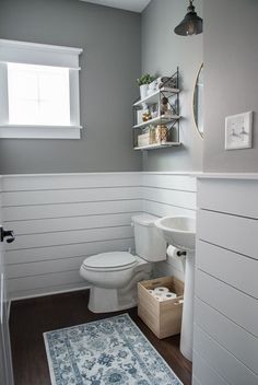 Check out this beautiful powder room reveal! This tiny bathroom was transformed . Check out this beautiful powder room reveal! This tiny bathroom was transformed from boring to fresh and modern! I love the shiplap and the modern classic decorations. Downstairs Bathroom, Bathroom Renos, Wainscoting Bathroom, Bathroom Cabinets, Bathroom Layout, Bathroom Wall Ideas, Simple Bathroom, Wainscoting Styles, Colorful Bathroom