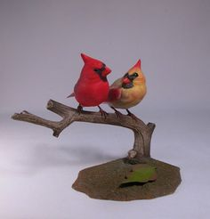This is an original, fully detailed carving. The size of male cardinal is 5 inches from the tip of the crest to the end of tail. The size of female
