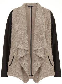 The statement coat is your key piece this season, so opt for the mink waterfall PU sleeve jacket. Trend-led and sophisticated, the plus size coat boasts a wonderful textured mink body with soft lapels and a waterfall front, accented with black PU sleeves and twin zipped pockets. - £59.50 (Search 05J39PNEU at www.evans.co.uk)