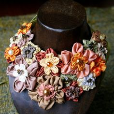 blossom necklace    Cream , brown and orange shade of silk taffeta flowers with grosgrain ribbon bib necklace.I use crystal , chip glass , chip stone and glass pearl as pollen