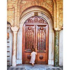 #kid #knocking on #wooden #door #byzantine #monastery #church #vlatadon #Thessaloniki #marble #pillars #bricks