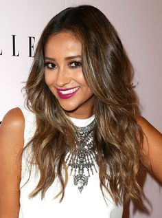 Shay Mitchell finished off her look with an ultra-feminine berry lip.