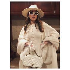 Fallon Carrington in a Eugenia Kim hat, Elizabeth & James sunglasses, a Dolce & Gabbana dress, a Roksanda Ilincic coat, a Chanel purse and Causse Gantier gloves on Dynasty 1x15