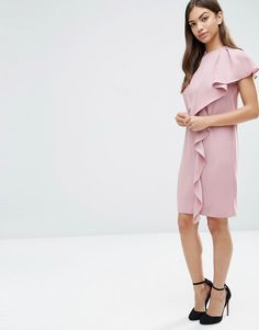 The Sleeveless Ruffle Front Shift Dress is a must have for any summer capsule wardrobe.