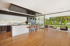 Open plan kitchen and living. Architecture and Interior Design by ID Studios Pyrmont