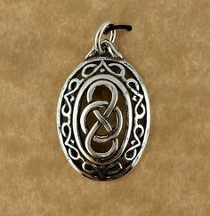Sterling silver oval Celtic Knot unisex pendant by celtictreasures