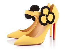 Zapatos amarillos con flor Louboutin