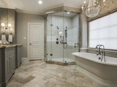 French Country House Tour- white subway tiles in shower, herringbone tile pattern on floor. neutral bathroom