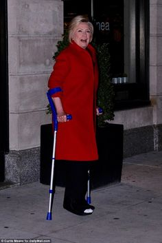 Is this Hillary's superhero act? Clinton hobbles out of Chelsea's on crutches before ditching them on stage to pick up 'Wonder Woman' award on her birthday! Broken Foot, Chelsea Clinton, Crutches, 70th Birthday, Awards, Stage, Daughter, Normcore, Wonder Woman