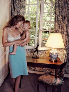 Marina Skopkareva celebrates the joys and challenges — aka chaos — of motherhood in Camilla Armbrust'sintimate, at home editorial for Glamour Germany's February issue. Stylist Katharina Muller-lutz chooses pared-down fluidity of a romantic nature as a reminder that inside every mother is a woman who delights.