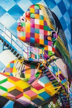 La street art caleidoscopica di Eduardo Kobra #streetart #urbanism #art #theurbaneye #streetartproject L'artista brasiliano Eduardo Kobra utilizza colori brillanti e linee audaci pur rimanendo fedele ad un tema caleidoscopico in tutta la sua arte. La tecnica di ripetere quadrati e triangoli gli permette di portare in vita i personaggi famosi che ritrae nelle sue opere. I suoi lavori sono rappresentazioni dettagliate di epoche pas