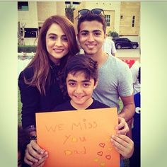 """A Lebanese singer, Julia Boutros and her boys holding a sign that says """"We miss you Dad"""".  When you tell your parents how thankful you are for them, how much you miss them and love them, you'll certainly make their day, if not their life! #JuliaBoutros #Kindness #Lebanon #Beirut"""