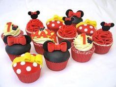 Minnie Mouse inspired cupcakes for Maya's 1st Birthday! All decorations are hand made and completely edible. A big thanks to Jessicakes for the amazing ruffle tutorial, they were great fun to make and perfect to show the ruffley skirt that Minnie...