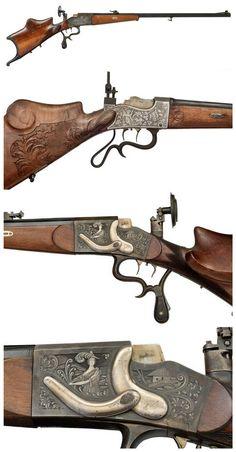 Engraved Haenel German Schuetzen single shot breechloading target rifle, late 19th century.