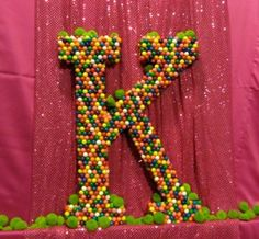 This crafty Bat Mitzvah Mom created a huge gumball letter K for her daughter's celebration. She glued the gum balls on the large letter that she bought at a Jo-Ann Fabric.