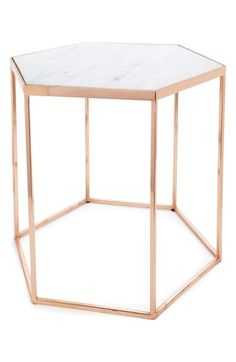 A bold goldtone finish and sleek, minimal lines further the modern appeal of a stylish accent table with an unconventional hexagonal base and a polished marble top. * x * Marble/metal.
