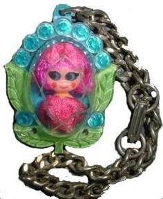 """Little Kiddle Locket Doll by Mattel. Basically a two inch doll in an over-sized plastic locket (doll was removable). I owned a couple in the late 1960's and treasured them, mostly because of the plastic """"gems"""" around the lockets."""