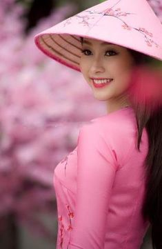 SEARCH TIP: There are many boards with the titles, 'Women of the World', 'People of the World', 'Faces' and 'People'. **Pink Ao dai, Vietnamese national dress**