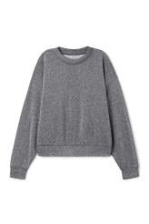 <p>The Glim Sweatshirt is a sparkling glitter piece inacosy oversized cut. Wide sleeves and boxy shape with a round neck and ribbed finishes create aneasygoingsilhouette.</p><p>- Size Small measures 128 cm in chest circumference,67 cm in length and50 cm in sleeve length.<br /></p>