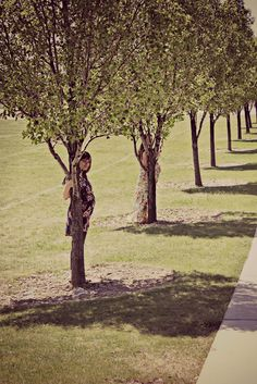 Sister maternity picture ideas: Hiding behind trees. (What pregnant girls?)