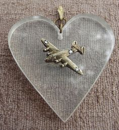 World War II era Lucite sweetheart pin with a B-24 bomber.