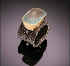 Chunky sterling silver and 18kt gold ring with topaz: $1200